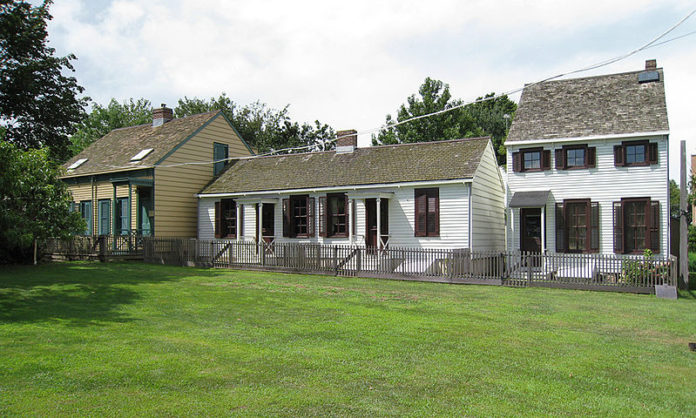Three of the few remaining homes in the historic Weeksville Heritage Center in Brooklyn NY