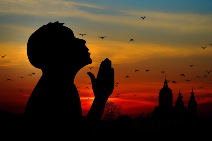 Praying to God to end discrimination based on color and the use of the derogatory N-word